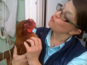 An urban farmer with one of her flock.