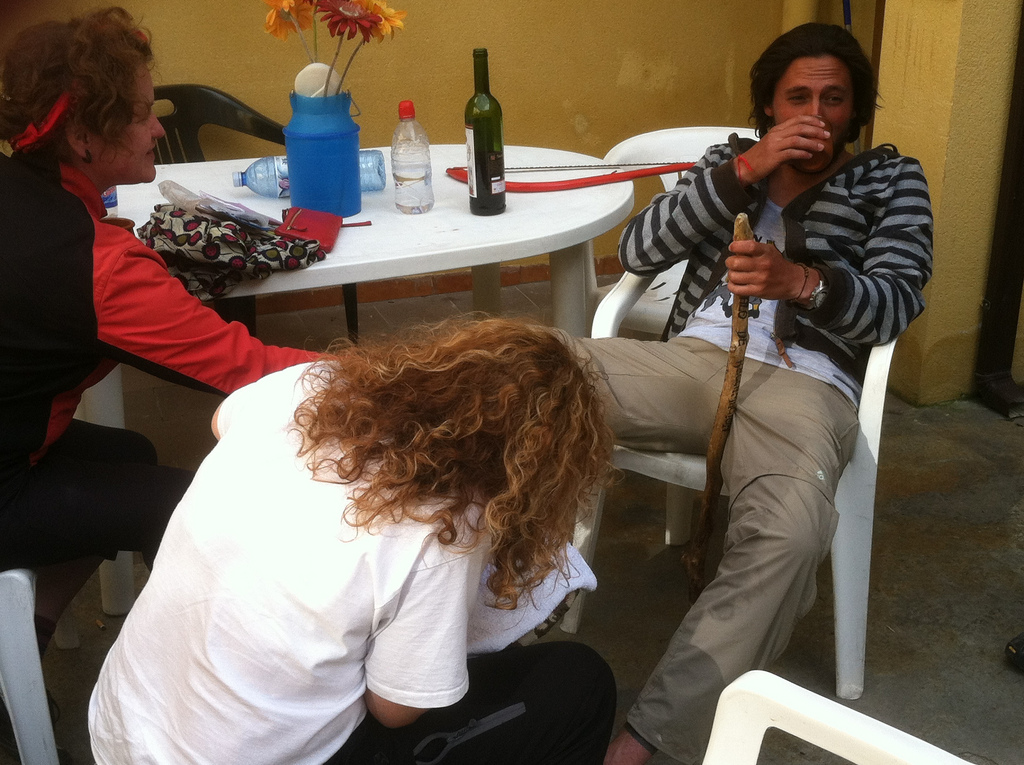 A Gracious Hospitalera working on Santiago's Blisters. Note the Hacksaw in the Background